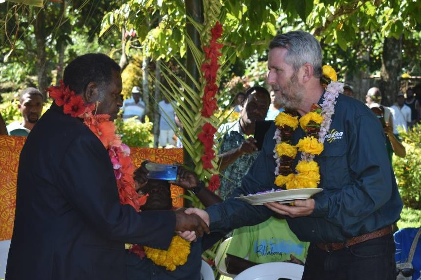 Peter Lynch (right) officially handling the keys for Talise Hydro Stage 2 to Vanuatu's Minister of Planning and Climate Change Adaptation, Ham Lini.